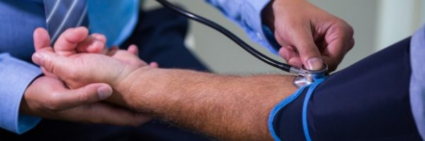 male-doctor-checking-blood-pressure-of-patient_1170-2153